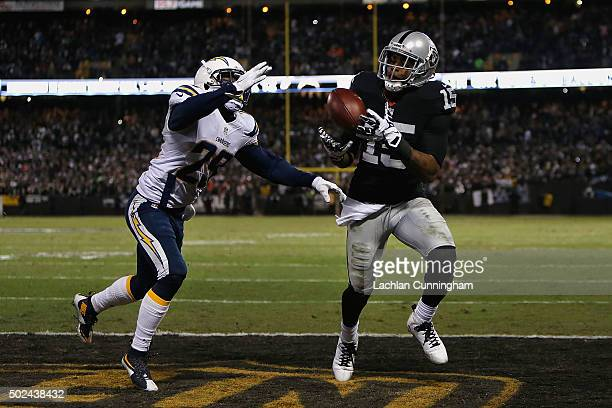 Wide receiver Michael Crabtree of the Oakland Raiders catches a touchdown ahead of corner back Craig Mager of the San Diego Chargers in the third...
