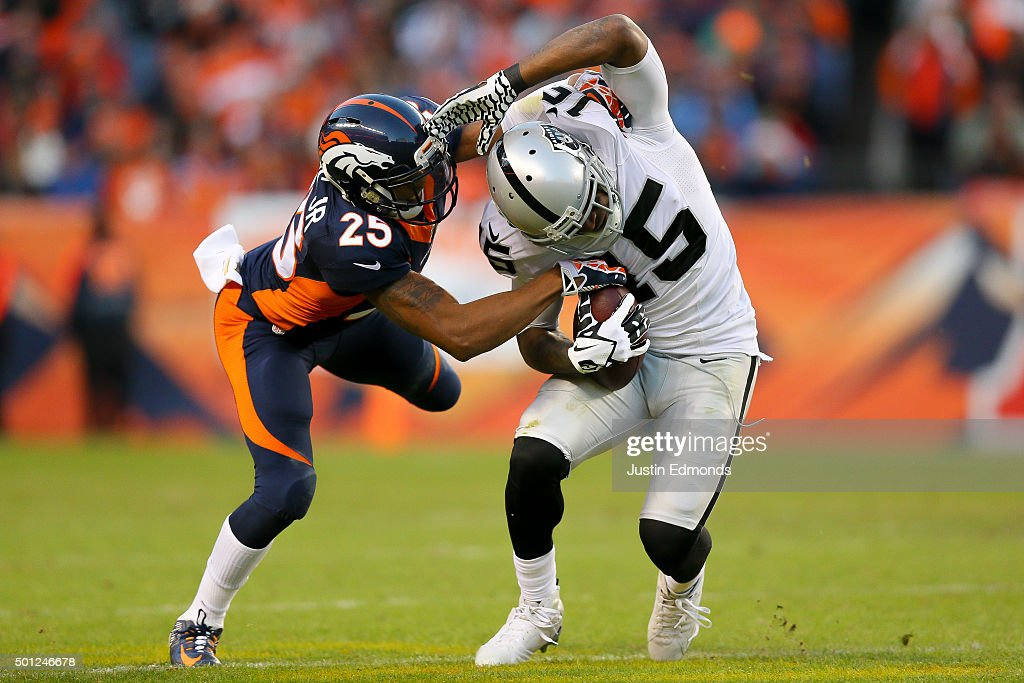 Wide receiver <a gi-track='captionPersonalityLinkClicked' href=/galleries/search?phrase=Michael+Crabtree&family=editorial&specificpeople=4650635 ng-click='$event.stopPropagation()'>Michael Crabtree</a> #15 of the Oakland Raiders is wrapped up and tackled by cornerback <a gi-track='captionPersonalityLinkClicked' href=/galleries/search?phrase=Chris+Harris+-+American+Football+Cornerback&family=editorial&specificpeople=15029474 ng-click='$event.stopPropagation()'>Chris Harris</a> #25 of the Denver Broncos after a 4 yard reception at Sports Authority Field at Mile High on December 13, 2015 in Denver, Colorado.