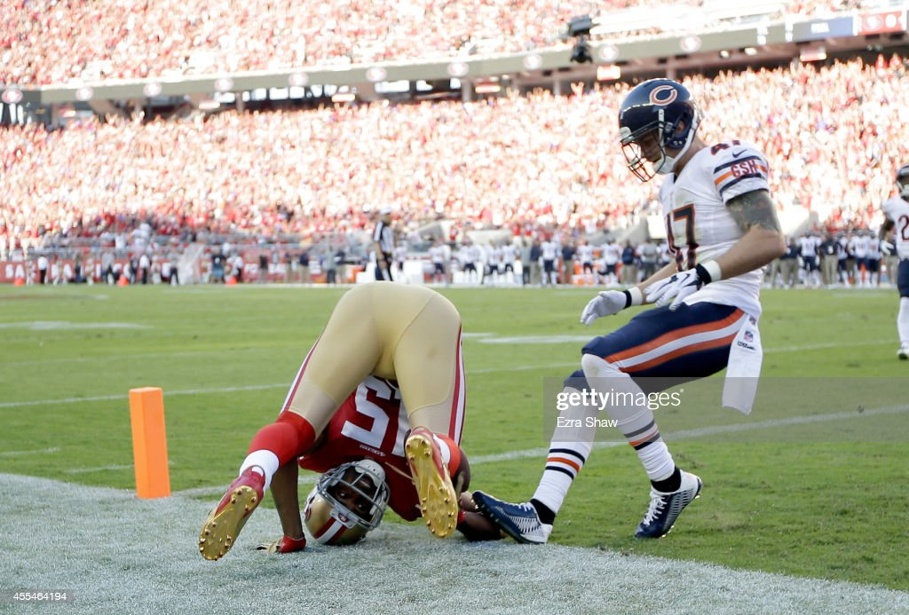 Wide receiver Michael Crabtree of the San Francisco 49ers catches a touchdown pass in the first quarter of a game against the Chicago Bears at Levi's...