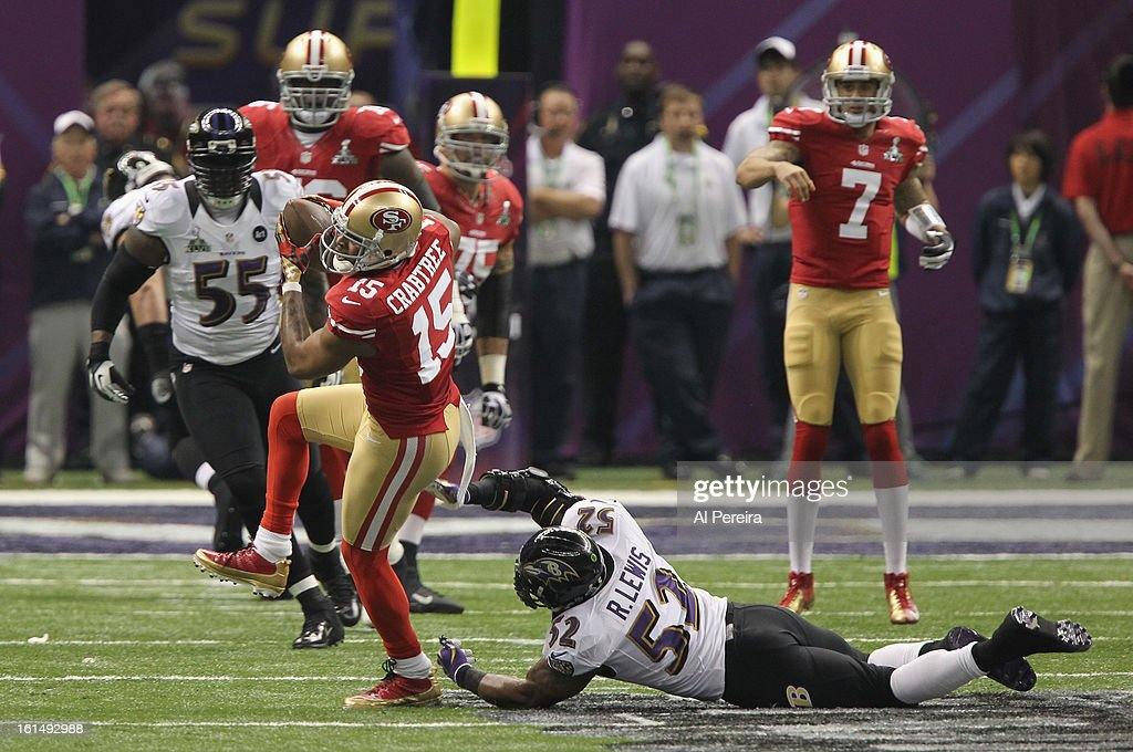 Wide Receiver Michael Crabtree #15 of the San Francisco 49ers catches the ball against the Baltimore Ravens during Super Bowl XLVII at Mercedes-Benz Superdome on February 3, 2013 in New Orleans, Louisiana.