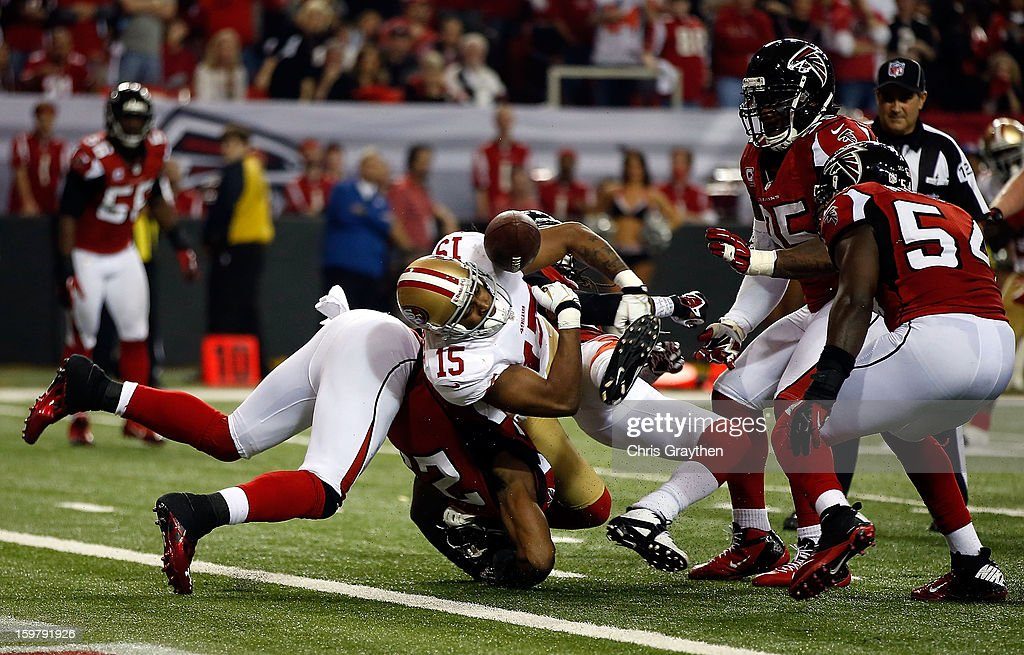 Wide receiver Michael Crabtree #15 of the San Francisco 49ers fumbles the football and the ball is recovered by outside linebacker Stephen Nicholas #54 of the Atlanta Falcons on the Atlanta one-yardline in the fourth quarter in the NFC Championship game at the Georgia Dome on January 20, 2013 in Atlanta, Georgia.