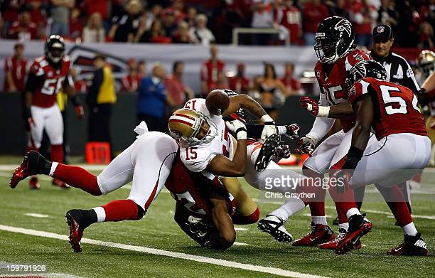 Wide receiver Michael Crabtree of the San Francisco 49ers fumbles the football and the ball is recovered by outside linebacker Stephen Nicholas of...