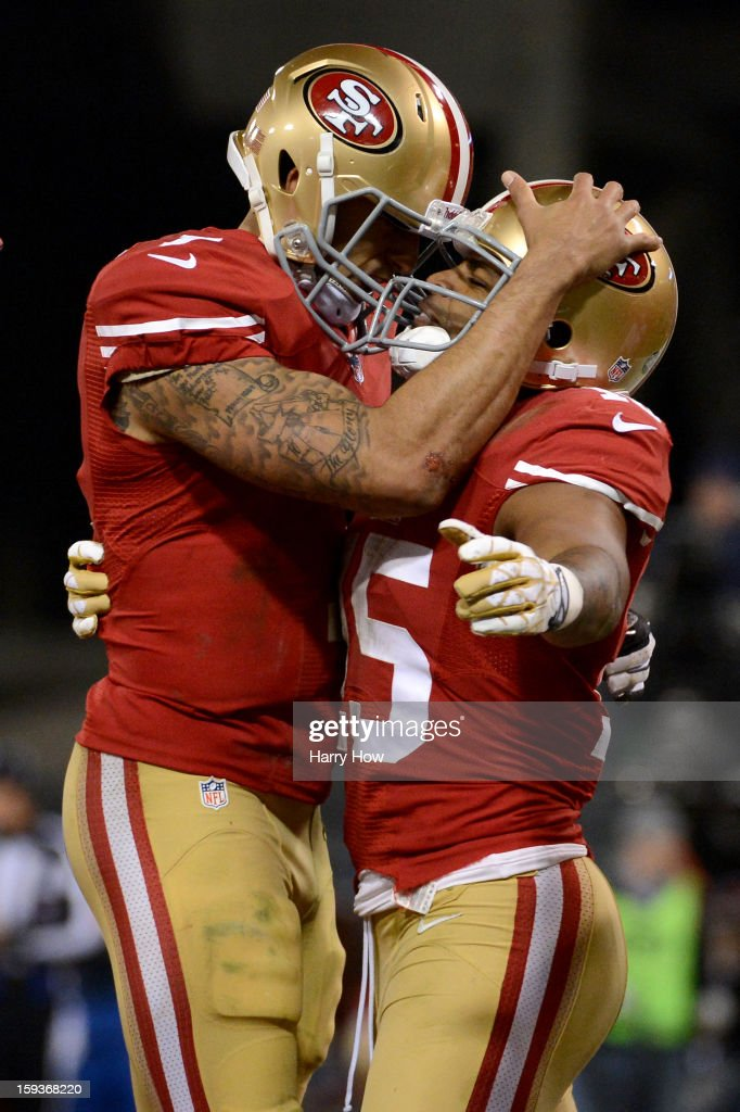Wide receiver Michael Crabtree #15 of the San Francisco 49ers hugs quarterback Colin Kaepernick #7 after a touchdown in the second quarter against the Green Bay Packers during the NFC Divisional Playoff Game at Candlestick Park on January 12, 2013 in San Francisco, California.