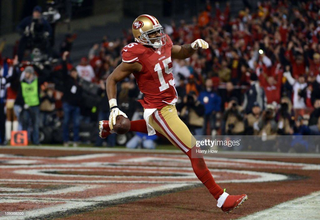 Wide receiver <a gi-track='captionPersonalityLinkClicked' href=/galleries/search?phrase=Michael+Crabtree&family=editorial&specificpeople=4650635 ng-click='$event.stopPropagation()'>Michael Crabtree</a> #15 of the San Francisco 49ers runs the ball in for a touchdown thrown by quarterback <a gi-track='captionPersonalityLinkClicked' href=/galleries/search?phrase=Colin+Kaepernick&family=editorial&specificpeople=5525694 ng-click='$event.stopPropagation()'>Colin Kaepernick</a> #7 in the second quarter against the Green Bay Packers during the NFC Divisional Playoff Game at Candlestick Park on January 12, 2013 in San Francisco, California.