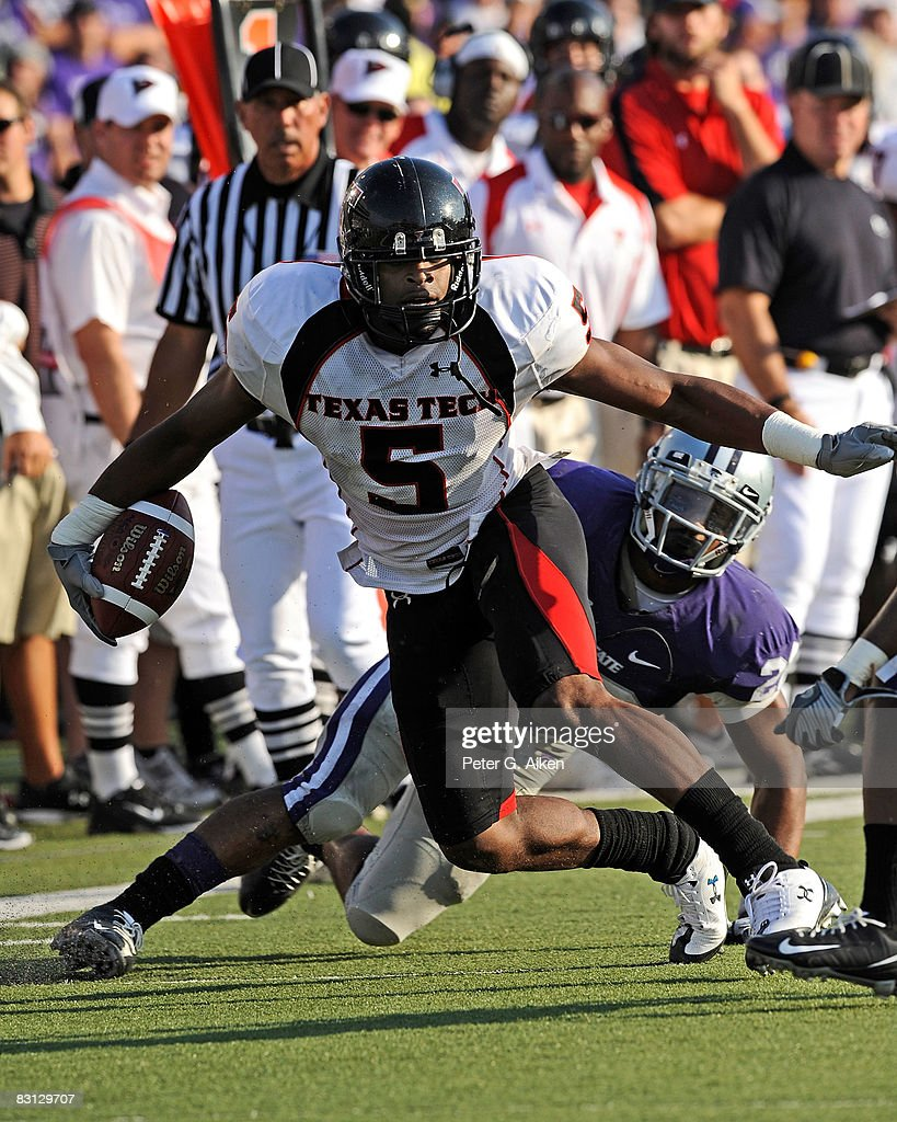 Wide receiver Michael Crabtree of the Texas Tech Red Raiders rushes up field in the first half for a first down during a game against the Kansas...