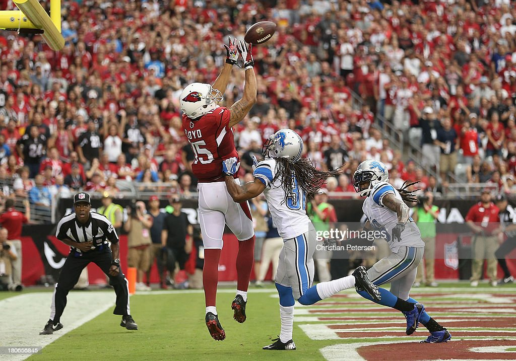 Wide receiver Michael Floyd of the Arizona Cardinals attempts to catch a pass in the endzone but landed out of bounds from defensive back Rashean...