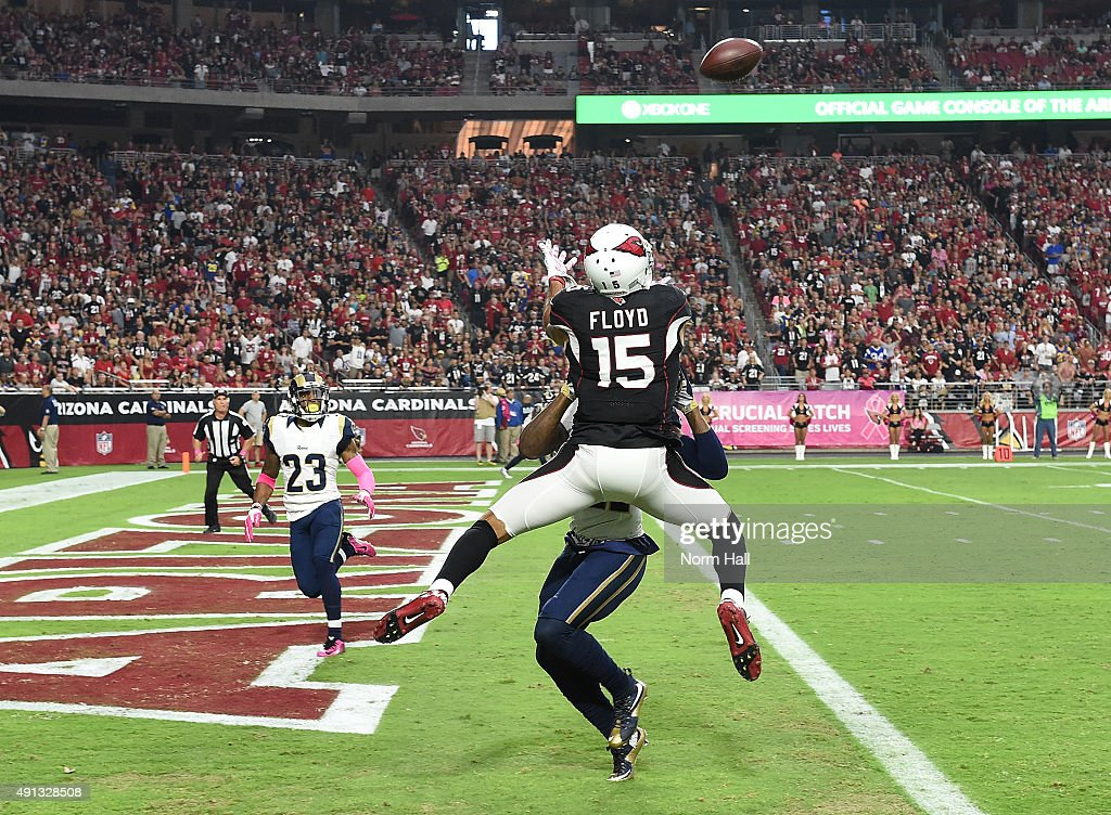 Wide receiver Michael Floyd #15 of the Arizona Cardinals can't haul in a pass while being defended by cornerback Janoris Jenkins #21 of the St Louis Rams during the first quarter of the NFL game at University of Phoenix Stadium on October 4, 2015 in Glendale, Arizona.