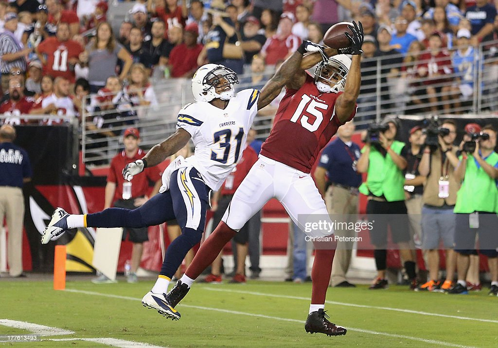 Wide receiver Michael Floyd #15 of the Arizona Cardinals catches a 16 yard touchdown reception past cornerback Gregory Gatson #31 of the San Diego Chargers during the third quarter of the preseason NFL game at the University of Phoenix Stadium on August 24, 2013 in Glendale, Arizona.