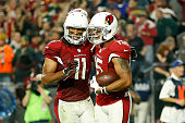 Wide receiver Michael Floyd of the Arizona Cardinals celebrates his 9yard fourth quarter touchdown catch with wide receiver Larry Fitzgerald in the...