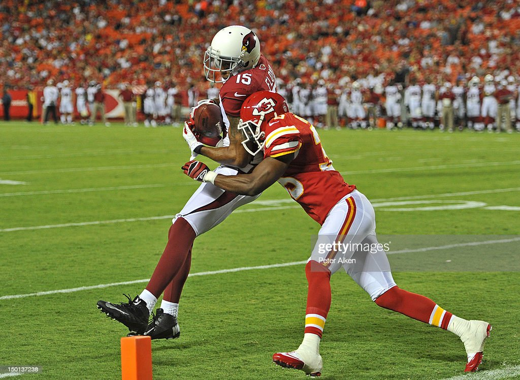 Wide receiver Michael Floyd #15 of the Arizona Cardinals makes a catch against pressure from defensive back <a gi-track='captionPersonalityLinkClicked' href=/galleries/search?phrase=Jacques+Reeves&family=editorial&specificpeople=756498 ng-click='$event.stopPropagation()'>Jacques Reeves</a> #35 of the Kansas City Chiefs during the second half on August 10, 2012 at Arrowhead Stadium in Kansas City, Missouri. Kansas City defeated Arizona 27-17.