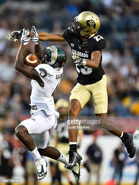 Wide receiver Michael Gallup of the Colorado State Rams goes up for a pass under coverage by defensive back Ahkello Witherspoon of the Colorado...
