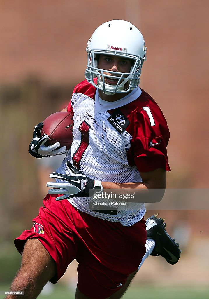 Wide receiver Michael Rios #1 of the Arizona Cardinals runs with the football as he practices at the team's training center facility on May 10, 2013 in Tempe, Arizona.