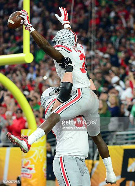 Wide receiver Michael Thomas of the Ohio State Buckeyes celebrates his first quarter touchdown with offensive lineman Pat Elflein of the Ohio State...