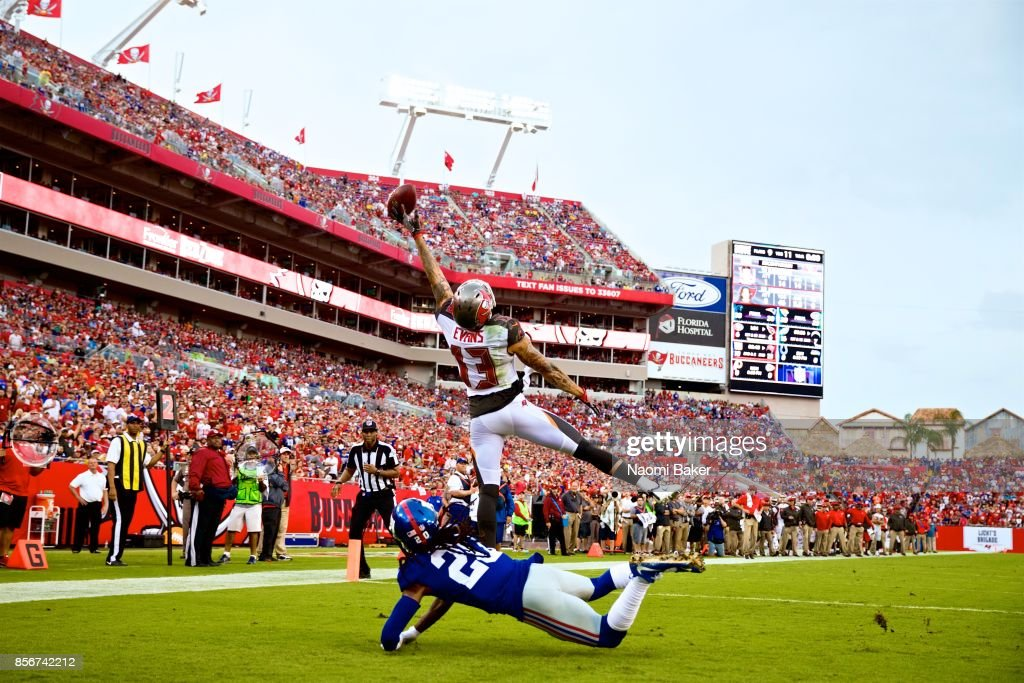 Wide receiver Mike Evans #13 of the Tampa Bay Bucaneers attempts a one handed catch in front of Janoris Jenkins #20 of the New York giants during the second quarter of an NFL football game at Raymond James Stadium on October 1, 2017 in Tampa, Florida. The Buccanners defeated the Giants 25 to 23.