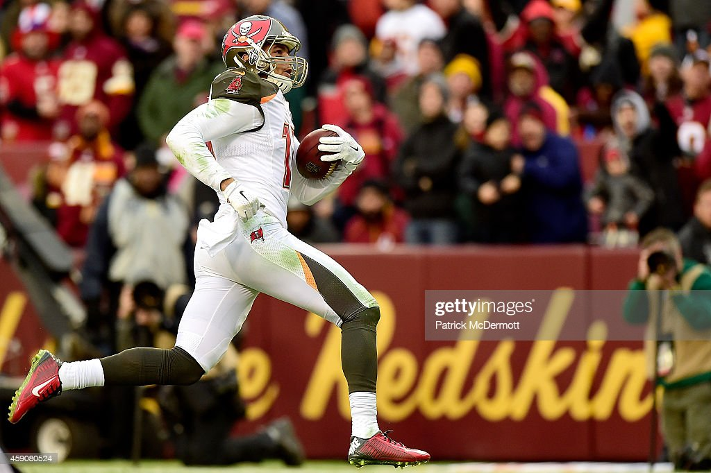 Wide receiver <a gi-track='captionPersonalityLinkClicked' href=/galleries/search?phrase=Mike+Evans+-+American+Football+Wide+Receiver&family=editorial&specificpeople=12684996 ng-click='$event.stopPropagation()'>Mike Evans</a> #13 of the Tampa Bay Buccaneers catches a fourth quarter touchdown against the Washington Redskins at FedExField on November 16, 2014 in Landover, Maryland.
