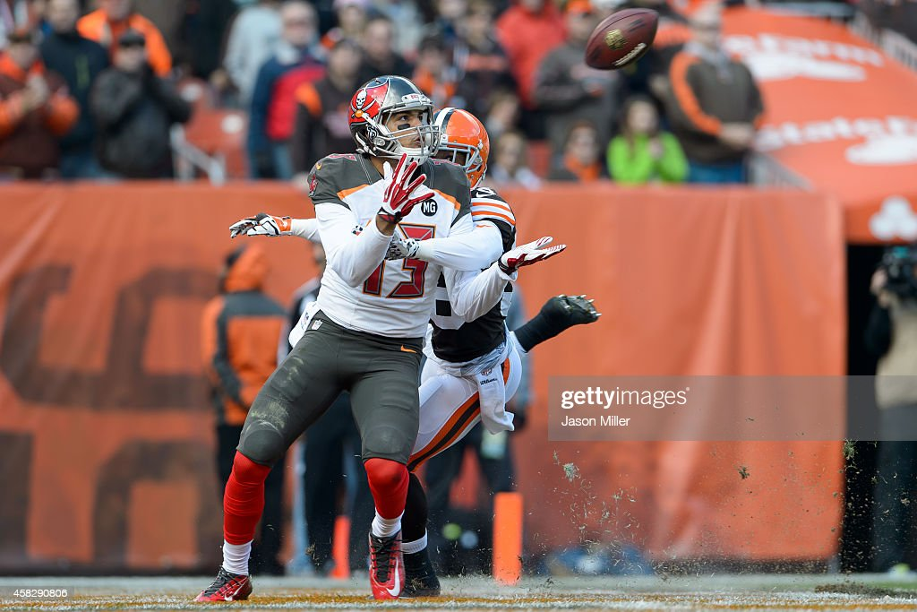 Wide receiver <a gi-track='captionPersonalityLinkClicked' href=/galleries/search?phrase=Mike+Evans+-+American+Football+Wide+Receiver&family=editorial&specificpeople=12684996 ng-click='$event.stopPropagation()'>Mike Evans</a> #13 of the Tampa Bay Buccaneers catches a touchdown pass while under pressure from defensive back <a gi-track='captionPersonalityLinkClicked' href=/galleries/search?phrase=K%27Waun+Williams&family=editorial&specificpeople=8222224 ng-click='$event.stopPropagation()'>K'Waun Williams</a> #36 of the Cleveland Browns during the first half at FirstEnergy Stadium on November 2, 2014 in Cleveland, Ohio.