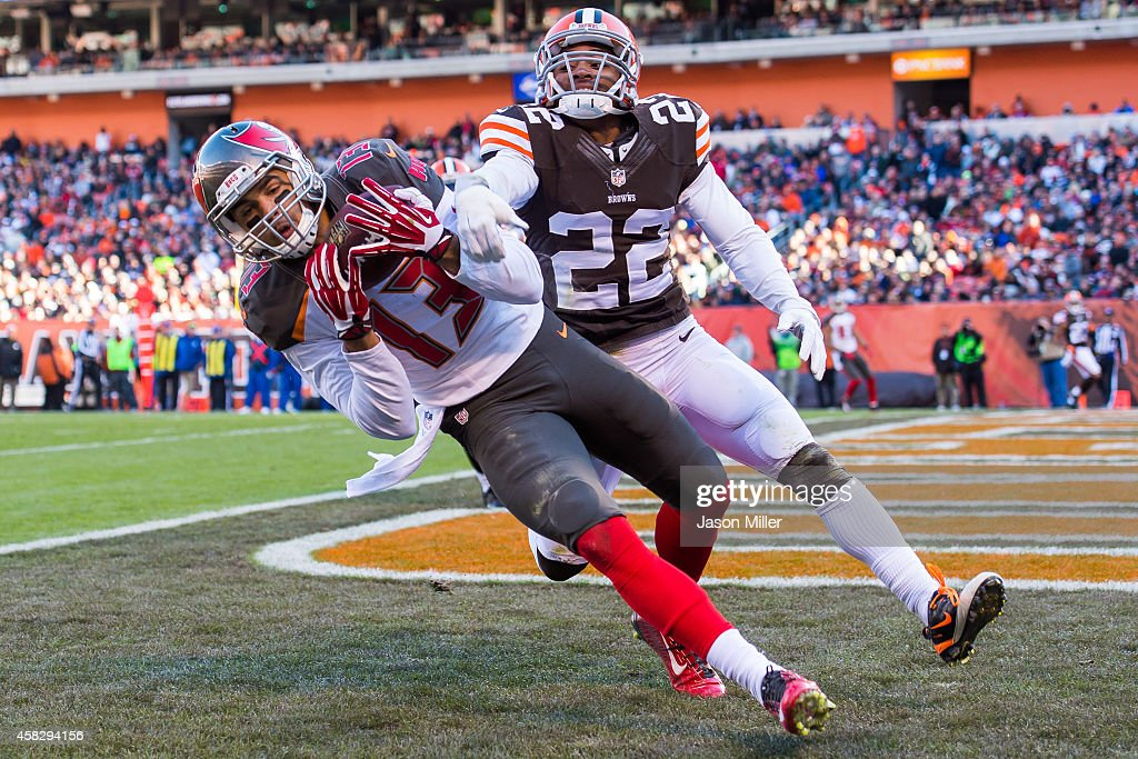 Wide receiver <a gi-track='captionPersonalityLinkClicked' href=/galleries/search?phrase=Mike+Evans+-+American+Football+Wide+Receiver&family=editorial&specificpeople=12684996 ng-click='$event.stopPropagation()'>Mike Evans</a> #13 of the Tampa Bay Buccaneers catches a touchdown pass while under pressure from cornerback <a gi-track='captionPersonalityLinkClicked' href=/galleries/search?phrase=Buster+Skrine&family=editorial&specificpeople=6547689 ng-click='$event.stopPropagation()'>Buster Skrine</a> #22 of the Cleveland Browns during the second half at FirstEnergy Stadium on November 2, 2014 in Cleveland, Ohio. The Browns defeated the Buccaneers 22-17.