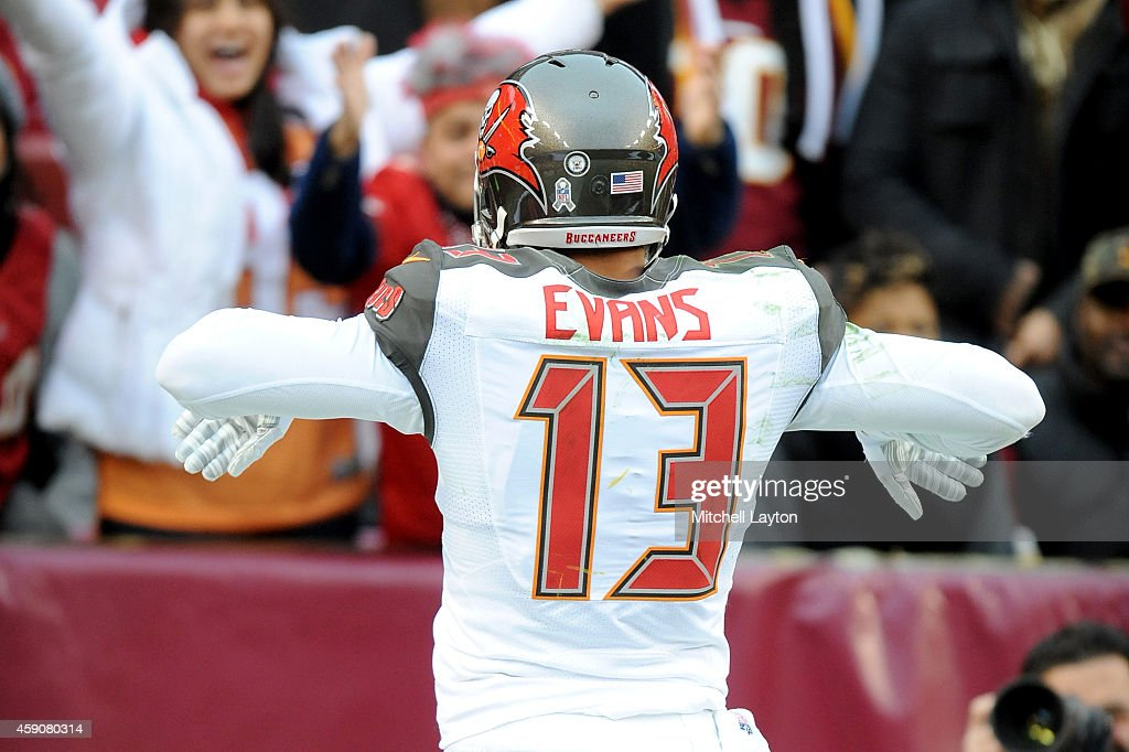 Wide receiver <a gi-track='captionPersonalityLinkClicked' href=/galleries/search?phrase=Mike+Evans+-+American+Football+Wide+Receiver&family=editorial&specificpeople=12684996 ng-click='$event.stopPropagation()'>Mike Evans</a> #13 of the Tampa Bay Buccaneers celebrates after catching a fourth quarter touchdown against the Washington Redskins at FedExField on November 16, 2014 in Landover, Maryland.