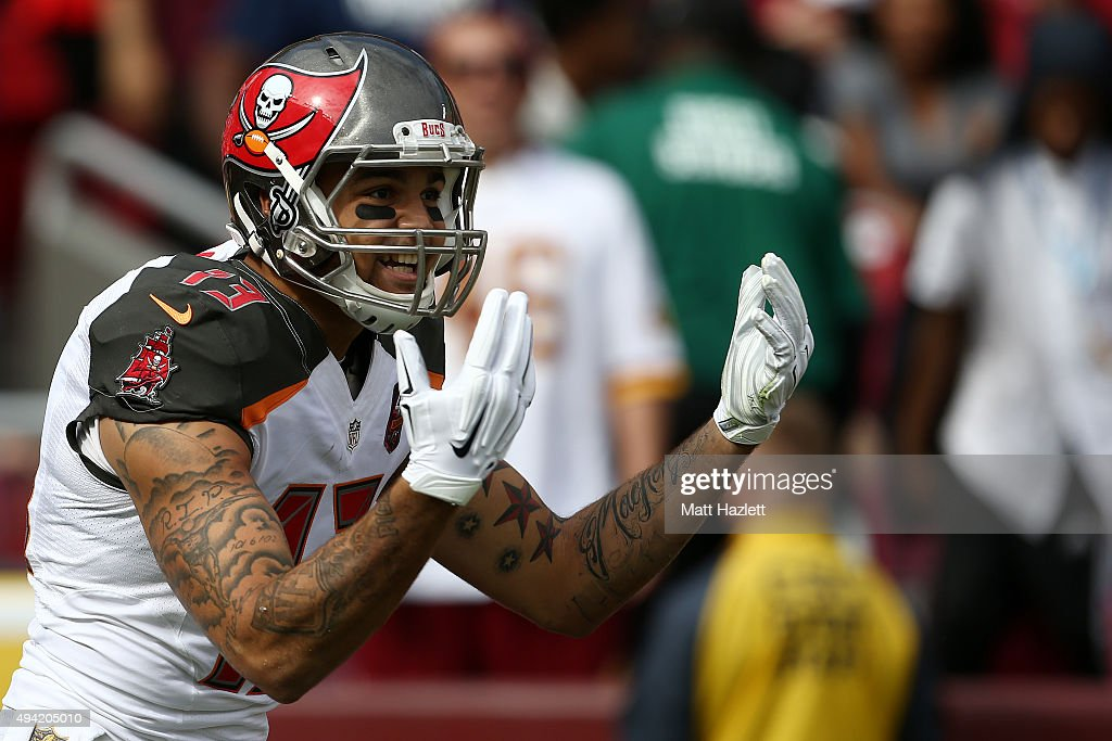 Wide receiver <a gi-track='captionPersonalityLinkClicked' href=/galleries/search?phrase=Mike+Evans+-+American+Football+Wide+Receiver&family=editorial&specificpeople=12684996 ng-click='$event.stopPropagation()'>Mike Evans</a> #13 of the Tampa Bay Buccaneers celebrates after scoring a first quarter touchdown during a game against the Washington Redskins at FedExField on October 25, 2015 in Landover, Maryland.