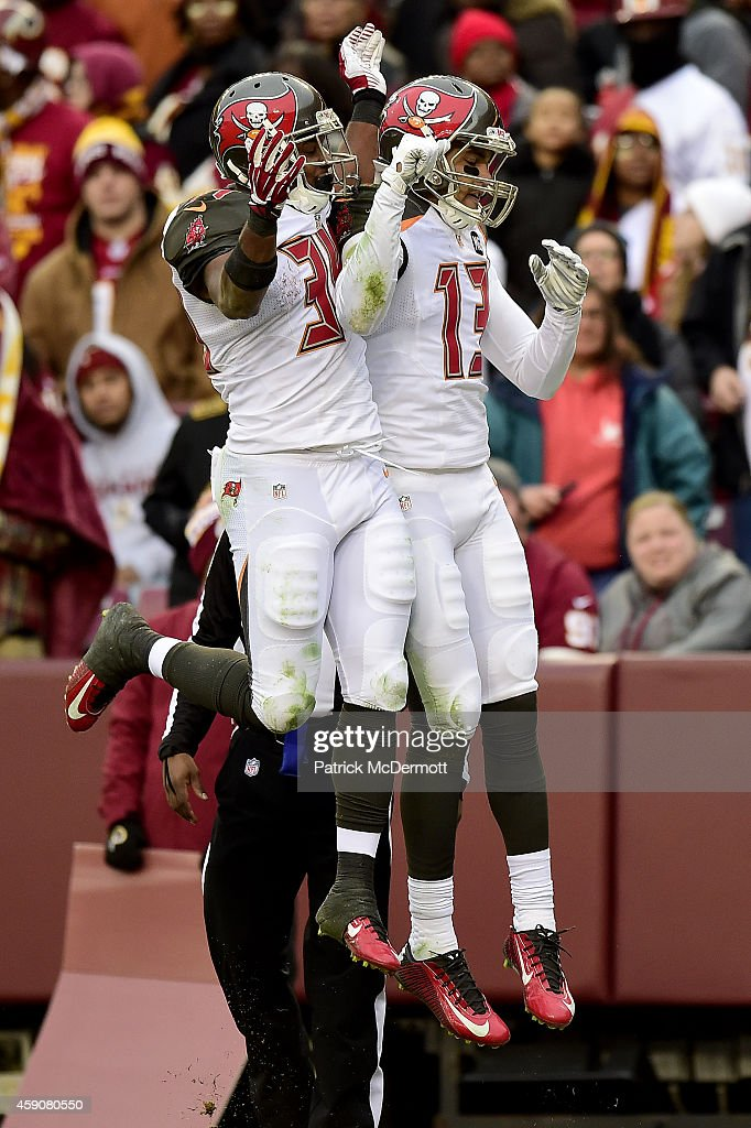 Wide receiver <a gi-track='captionPersonalityLinkClicked' href=/galleries/search?phrase=Mike+Evans+-+American+Football+Wide+Receiver&family=editorial&specificpeople=12684996 ng-click='$event.stopPropagation()'>Mike Evans</a> #13 of the Tampa Bay Buccaneers celebrates with running back <a gi-track='captionPersonalityLinkClicked' href=/galleries/search?phrase=Charles+Sims+-+American+Football+Player&family=editorial&specificpeople=12800717 ng-click='$event.stopPropagation()'>Charles Sims</a> #34 after catching a fourth quarter touchdown against the Washington Redskins at FedExField on November 16, 2014 in Landover, Maryland.