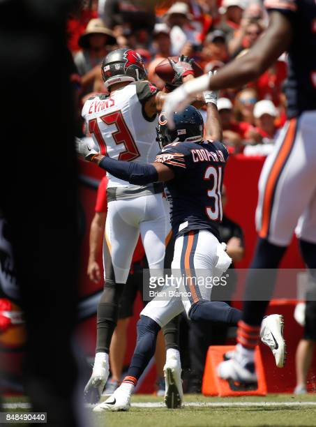 Wide receiver Mike Evans of the Tampa Bay Buccaneers hauls in a 13 yard pass from quarterback Jameis Winston in front of defensive back Marcus Cooper...