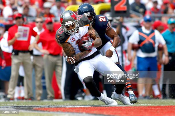 Wide receiver Mike Evans of the Tampa Bay Buccaneers hauls in a pass from quarterback Jameis Winston in front of strong safety Quintin Demps of the...