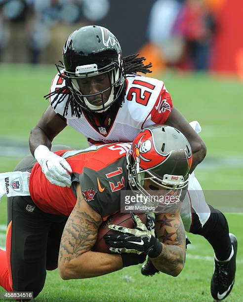 Wide receiver Mike Evans of the Tampa Bay Buccaneers is tackled by cornerback Desmond Trufant of the Atlanta Falcons at Raymond James Stadium on...