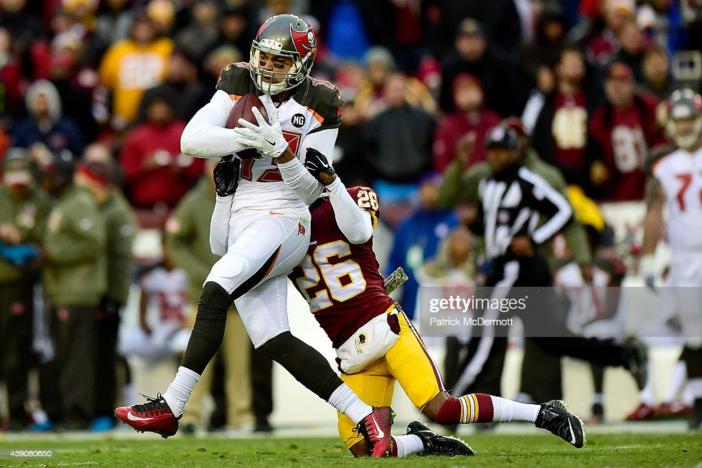 Wide receiver <a gi-track='captionPersonalityLinkClicked' href=/galleries/search?phrase=Mike+Evans+-+American+Football+Wide+Receiver&family=editorial&specificpeople=12684996 ng-click='$event.stopPropagation()'>Mike Evans</a> #13 of the Tampa Bay Buccaneers is tackled by cornerback <a gi-track='captionPersonalityLinkClicked' href=/galleries/search?phrase=Bashaud+Breeland&family=editorial&specificpeople=8312329 ng-click='$event.stopPropagation()'>Bashaud Breeland</a> #26 of the Washington Redskins late in the third quarter at FedExField on November 16, 2014 in Landover, Maryland.