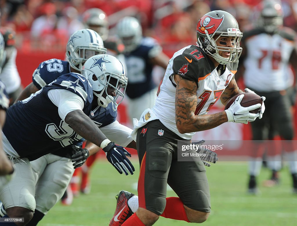 Wide receiver <a gi-track='captionPersonalityLinkClicked' href=/galleries/search?phrase=Mike+Evans+-+American+Football+Wide+Receiver&family=editorial&specificpeople=12684996 ng-click='$event.stopPropagation()'>Mike Evans</a> #13 of the Tampa Bay Buccaneers runs after the catch past defensive tackle David Irving #95 of the Dallas Cowboys in the second quarter at Raymond James Stadium on November 15, 2015 in Tampa, Florida.