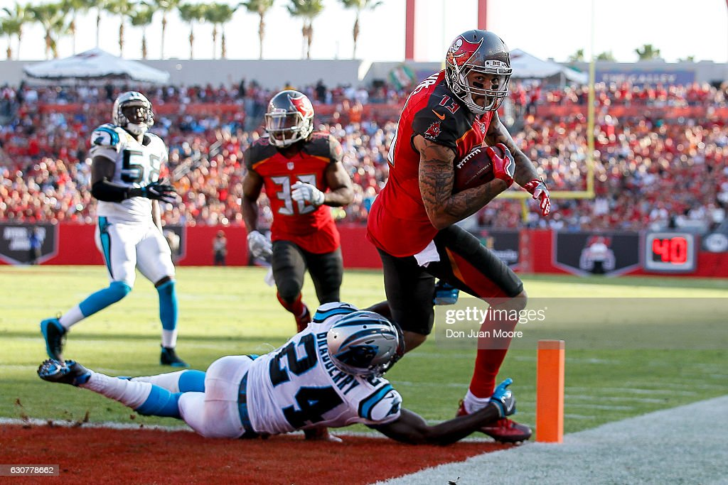 Wide receiver Mike Evans #13 of the Tampa Bay Buccaneers scores the game-winning touchdown catch over Cornerback James Bradberry #24 of the Carolina Panthers at Raymond James Stadium on January 1, 2017 in Tampa, Florida. The Buccaneers defeated the Panthers 17 to 16.