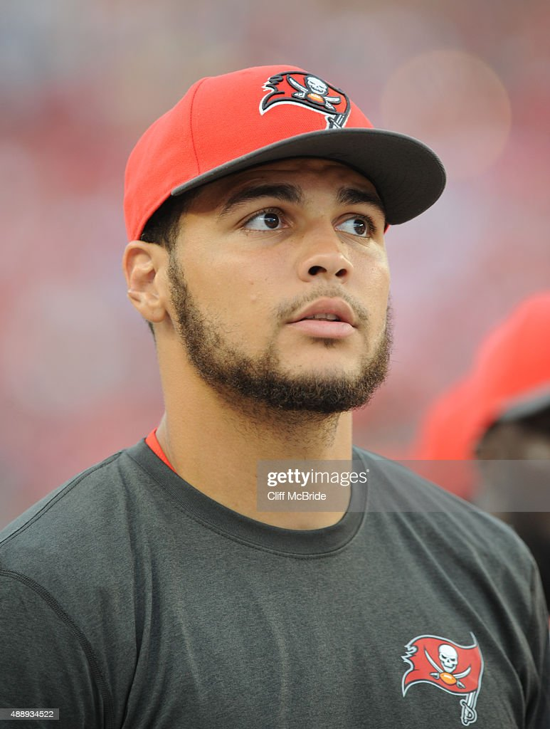 Wide receiver <a gi-track='captionPersonalityLinkClicked' href=/galleries/search?phrase=Mike+Evans+-+American+Football+Wide+Receiver&family=editorial&specificpeople=12684996 ng-click='$event.stopPropagation()'>Mike Evans</a> #13 of the Tampa Bay Buccaneers stands on the sidelines against the Tennessee Titans at Raymond James Stadium on September 13, 2015 in Tampa, Florida.