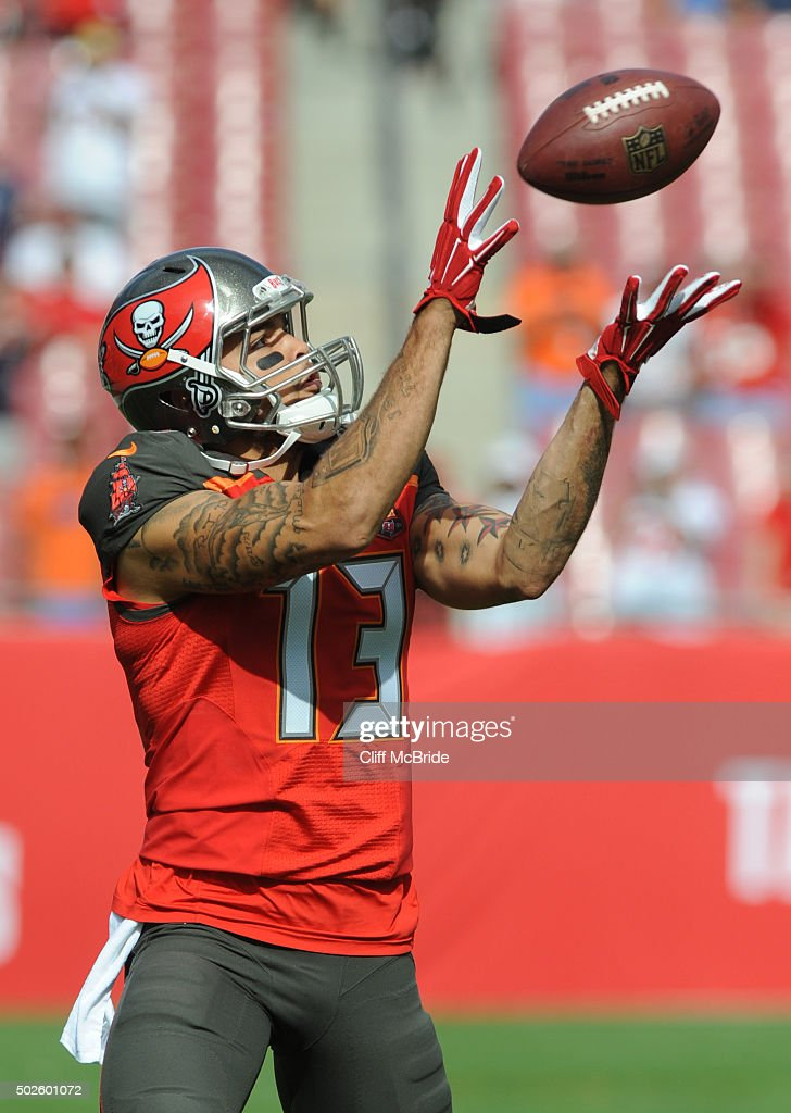 Wide receiver <a gi-track='captionPersonalityLinkClicked' href=/galleries/search?phrase=Mike+Evans+-+American+Football+Wide+Receiver&family=editorial&specificpeople=12684996 ng-click='$event.stopPropagation()'>Mike Evans</a> #13 of the Tampa Bay Buccaneers warms up before the game against the Chicago Bears at Raymond James Stadium on December 27, 2015 in Tampa, Florida.
