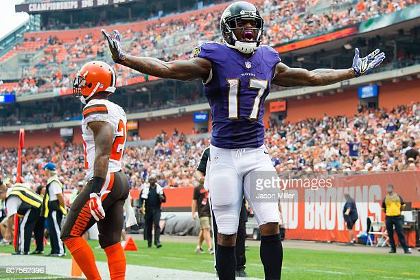 Wide receiver Mike Wallace of the Baltimore Ravens celebrates after catching a 17 yard touchdown pass from quarterback Joe Flacco during the third...