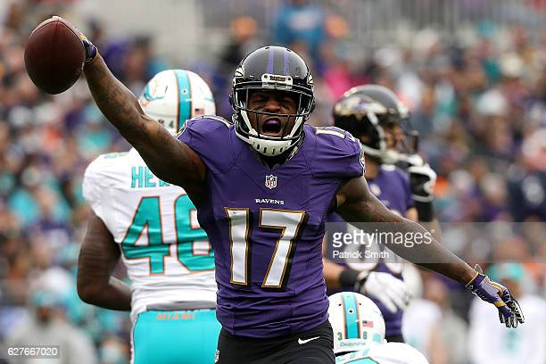 Wide receiver Mike Wallace of the Baltimore Ravens reacts after making a catch against the Miami Dolphins in the first quarter at MT Bank Stadium on...