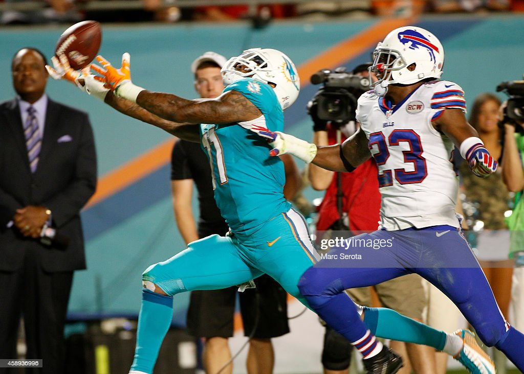 Wide receiver Mike Wallace #11 of the Miami Dolphins can't hold on to a second quarter pass as free safety Aaron Williams #23 of the Buffalo Bills defends in a game at Sun Life Stadium on November 13, 2014 in Miami Gardens, Florida.