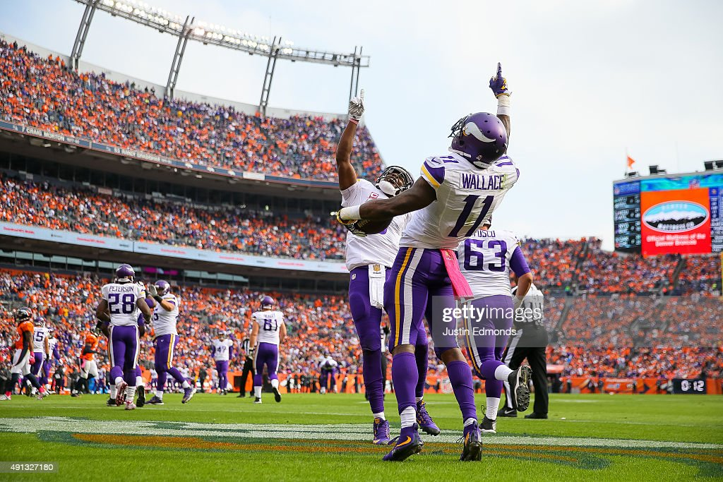 Wide receiver Mike Wallace #11 of the Minnesota Vikings celebrates with quarterback Teddy Bridgewater #5 after the two connected on a pass for a second quarter touchdown against the Denver Broncos during a game at Sports Authority Field at Mile High on October 4, 2015 in Denver, Colorado.