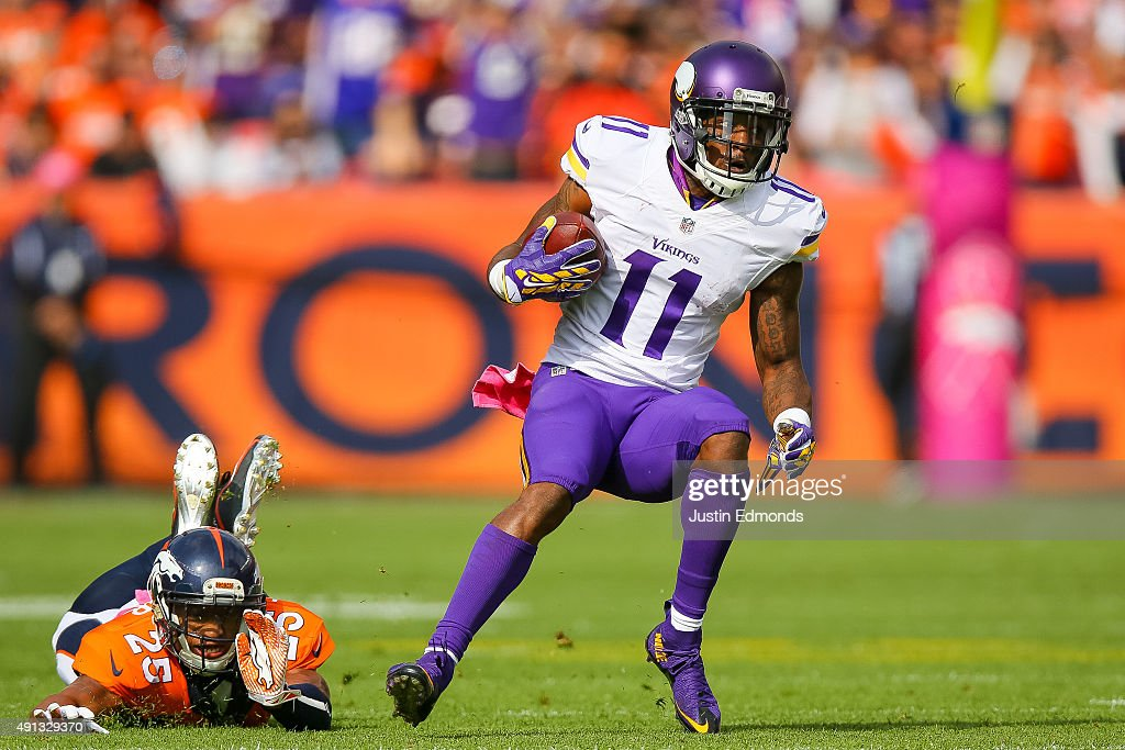Wide receiver <a gi-track='captionPersonalityLinkClicked' href=/galleries/search?phrase=Mike+Wallace+-+American+Football+Player&family=editorial&specificpeople=6123487 ng-click='$event.stopPropagation()'>Mike Wallace</a> #11 of the Minnesota Vikings looks for room to run after forcing a missed tackle by cornerback <a gi-track='captionPersonalityLinkClicked' href=/galleries/search?phrase=Chris+Harris+-+American+Football+Cornerback&family=editorial&specificpeople=15029474 ng-click='$event.stopPropagation()'>Chris Harris</a> #25 of the Denver Broncos during a game at Sports Authority Field at Mile High on October 4, 2015 in Denver, Colorado.