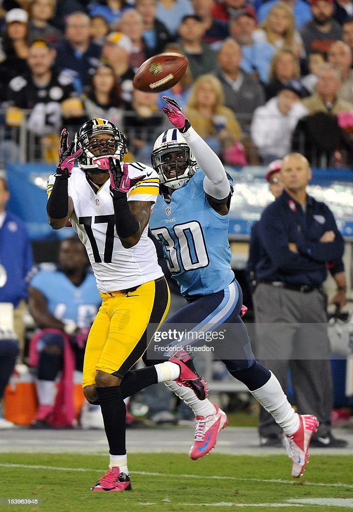 Wide receiver Mike Wallace #17 of the Pittsburgh Steelers catches a touchdown pass over the outstretched arms of Jason McCourty #30 of the Tennessee Titans at LP Field on October 11, 2012 in Nashville, Tennessee.