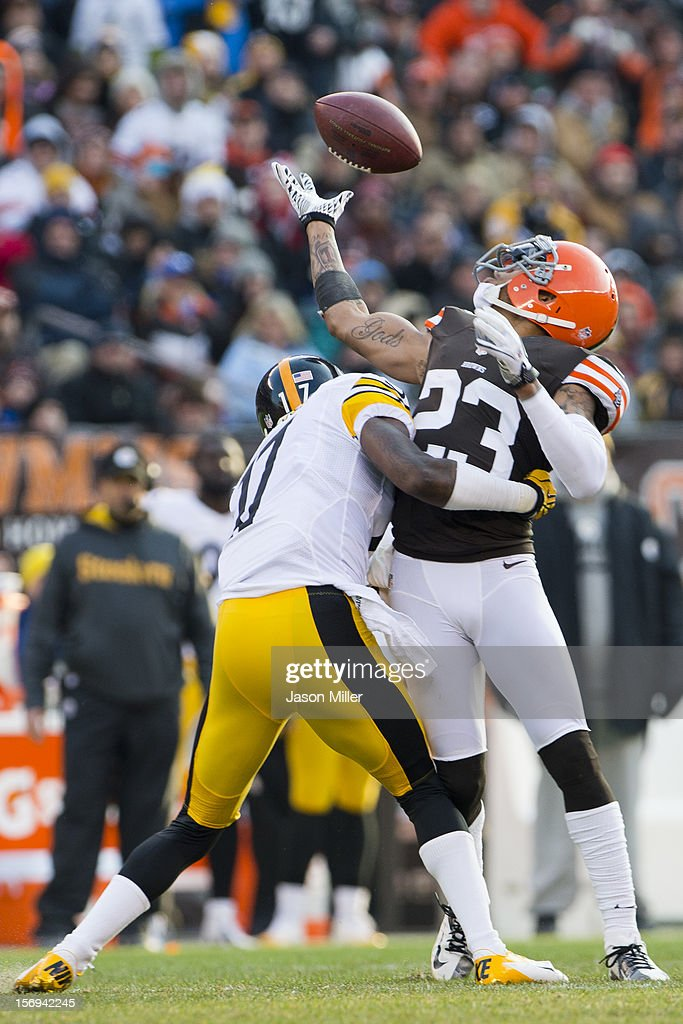Wide receiver Mike Wallace #17 of the Pittsburgh Steelers fights for a loose ball with cornerback Joe Haden #23 of the Cleveland Browns during the second half at Cleveland Browns Stadium on November 25, 2012 in Cleveland, Ohio. The Browns defeated the Steelers 20-14.