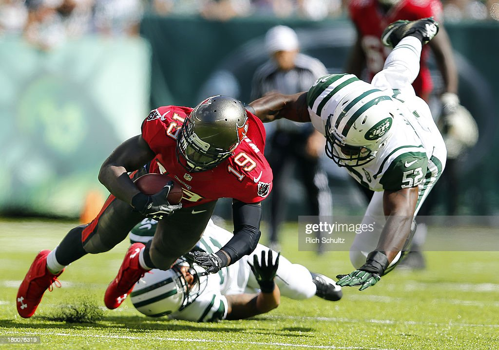Wide receiver Mike Williams #19 of the Tampa Bay Buccaneers makes a catch for a first down and is tackled by corner back <a gi-track='captionPersonalityLinkClicked' href=/galleries/search?phrase=Dee+Milliner&family=editorial&specificpeople=7425020 ng-click='$event.stopPropagation()'>Dee Milliner</a> #27 and linebacker David Harris #52 of the New York Jets during third quarter of a game at MetLife Stadium on September 8, 2013 in East Rutherford, New Jersey.
