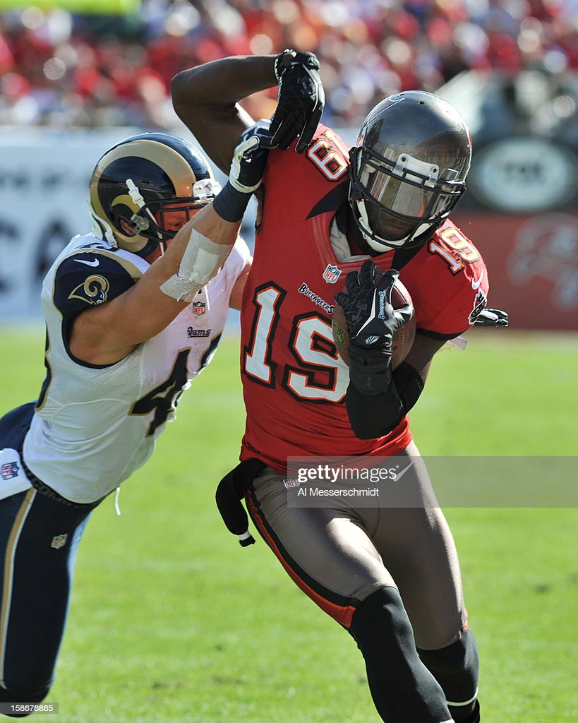 Wide receiver Mike Williams #19 of the Tampa Bay Buccaneers runs with a pass in the second quarter against the St. Louis Rams December 23, 2012 at Raymond James Stadium in Tampa, Florida.