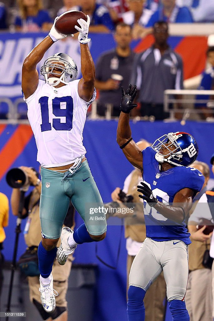 wide receiver Miles Austin of the Dallas Cowboys catches a ball on his way to scoring a touchdown in the fourth quarter against defensive back Justin...