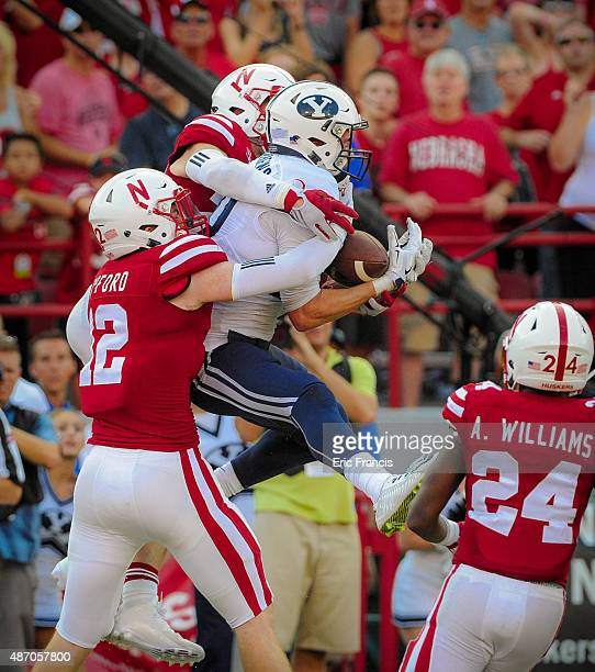 Wide receiver Mitch Mathews of the Brigham Young Cougars catches the game winning touchdown in front of linebacker Luke Gifford and safety Nate Gerry...