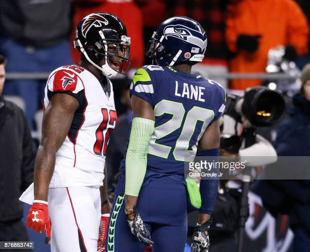 Wide receiver Mohamed Sanu of the Atlanta Falcons and cornerback Jeremy Lane of the Seattle Seahawks trade words after Lane was called for pass...
