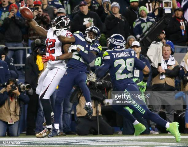 Wide receiver Mohamed Sanu of the Atlanta Falcons brings in a touchdown pass against cornerback Justin Coleman of the Seattle Seahawks and Earl...