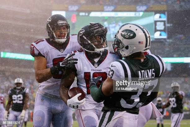Wide receiver Mohamed Sanu of the Atlanta Falcons celebrates his celebrates his touchdown with teammate tight end Austin Hooper against strong safety...