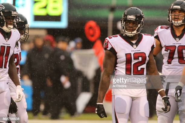 Wide Receiver Mohamed Sanu of the Atlanta Falcons in action against the New York Jets in a heavy rain storm during their game at MetLife Stadium on...