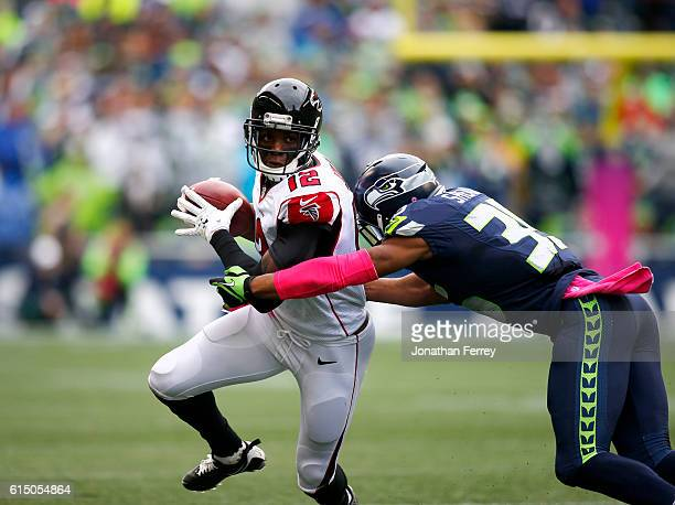 Wide receiver Mohamed Sanu of the Atlanta Falcons runs with the ball after a reception against defensive back DeShawn Shead Seattle Seahawks at...