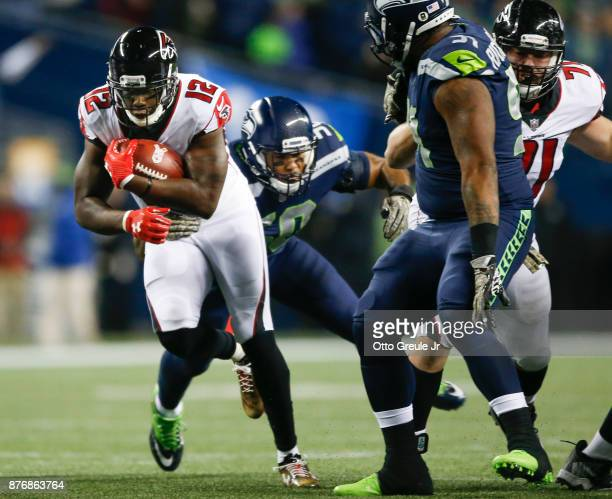 Wide receiver Mohamed Sanu of the Atlanta Falcons rushes against the Seattle Seahawks in the first quarter of the game at CenturyLink Field on...