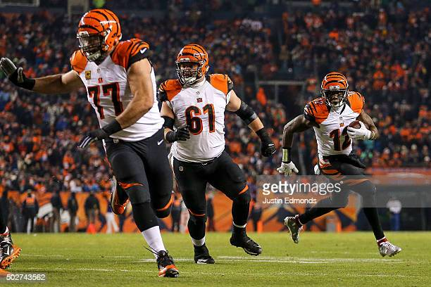 Wide receiver Mohamed Sanu of the Cincinnati Bengals rushes for a touchdown after taking a direct snap at the 6yard line as tackle Andrew Whitworth...
